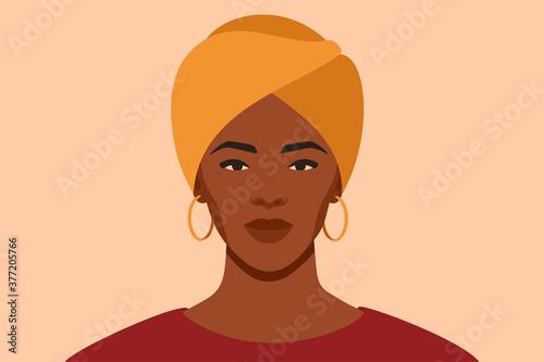 Canvas Print Black girl is wearing a yellow turban