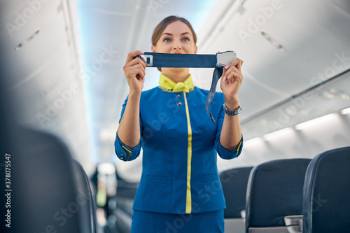 Canvas Print Charming air hostess training safety prior procedures to flight take off