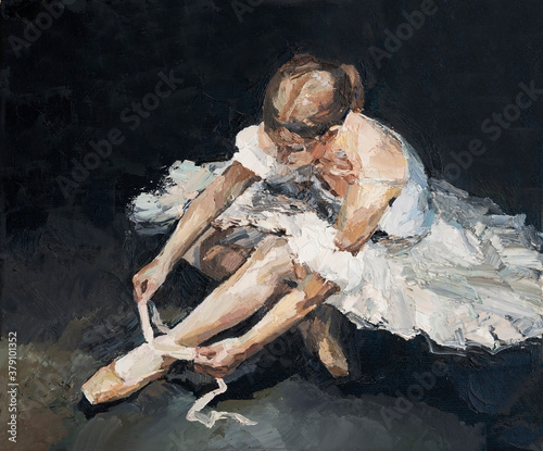 Canvastavla Young beautiful ballerina in lush white and light white dress sits on the floor before the performance, the background is black