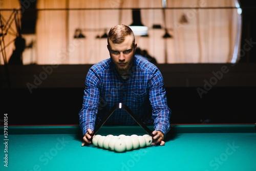 Fotografie, Obraz Playing billiard - Close-up shot of a man playing billiard