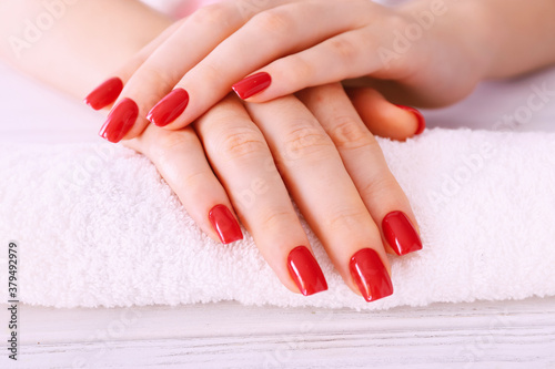 Photo Manicure - nice manicured woman nails with red nail polish