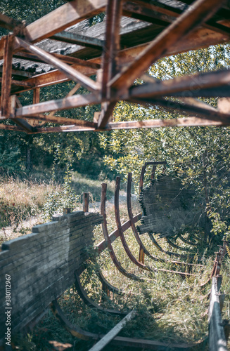 Old abandoned wooden bobsleigh track in summer by daylight Poster Mural XXL
