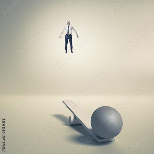 Fotografia, Obraz businessman uses a catapult to fly upwards.