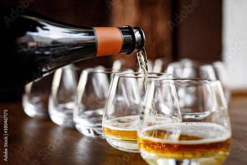 Fotografie, Tablou pouring cider into glass