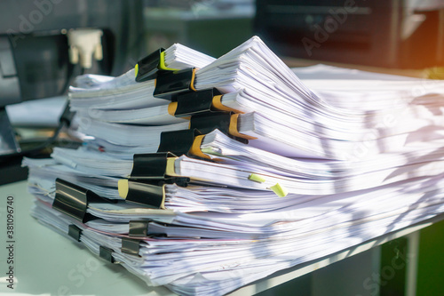 Fotografia Stack of insurance paperwork documents information of finance files on commercia