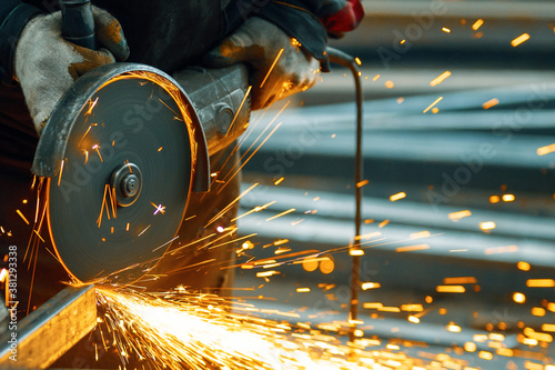 Fotografie, Tablou Cutting a metal beam using an angle grinder