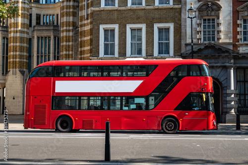 Wallpaper Mural Red London Buses operating during lockdown pandemic in Central London, UK due to Covid19 coronavirus