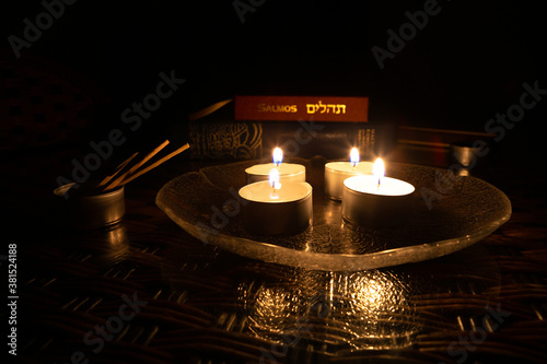 Fototapeta Candles lit on the day of Yom Kippur with the book of Psalms and the Bible in the background