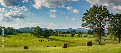 Obraz na plátně Hay bales in pasture on horse farm in shadow of the Blue Ridge Mountains in central Virginia near Charlottesville