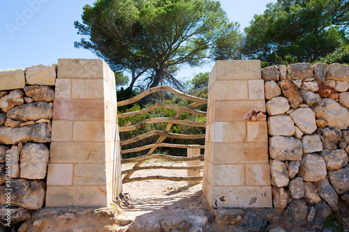 Menorca traditional wooden fence gate in Balearic islands