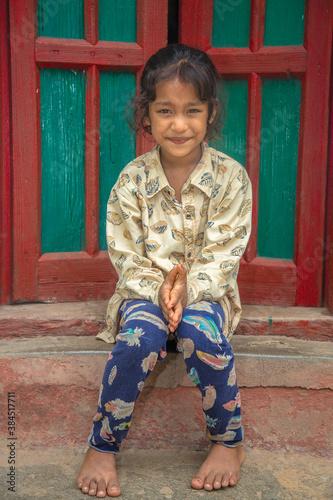 Rural Indian village girl in their village seating at home corridor Fototapeta