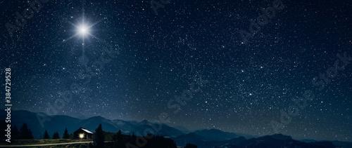 Leinwand Poster The star shines over the manger of christmas of Jesus Christ.
