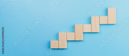 Fotografija Wooden block stacking as step stair blue background, Ladder of success in busine