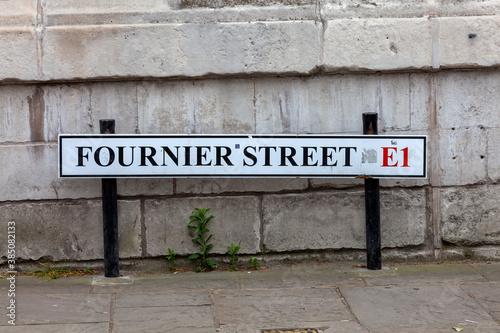 Valokuvatapetti Fournier Street road sign in Whitechapel Tower Hamlets London England UK known a