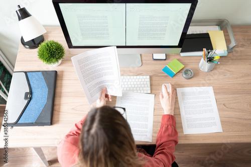 Obraz na plátně Female translator working on a document