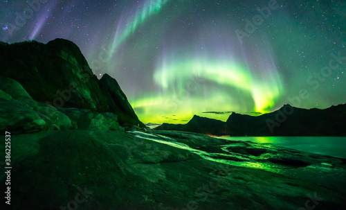 Canvas Print Amazing auroras storm above Rocks of Tungeneset Viewpoint, Senja, Norway
