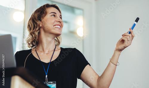 Fototapeta premium Smiling business woman giving a presentation