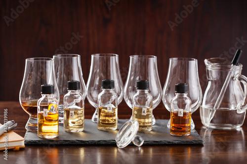 Obraz na płótnie tasting bottles and glasses of whisky spirit brandy cognac