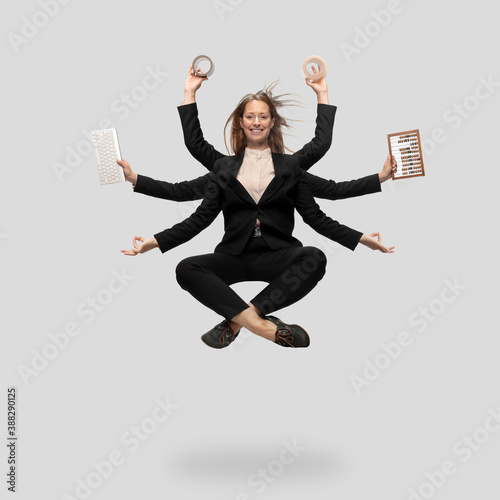 Wallpaper Mural Beautiful business woman, secretary, multi-armed manager levitating isolated on grey studio background