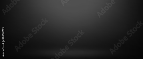 Foto Empty black color studio room background, can use for background and product dis