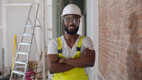 Valokuva Renovation handyman with protective glasses and helmet looking at camera