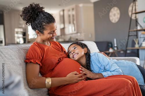 Happy lovely daughter hugging pregnant mother Fototapeta