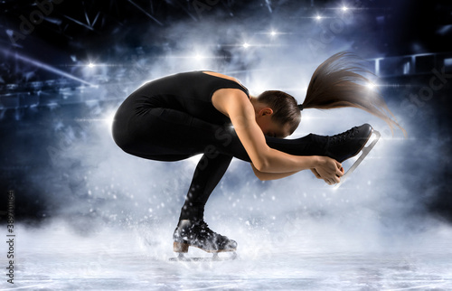 Fototapeta Sit spin. Woman figure skating in action. Sports banner