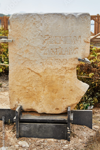 Fotografie, Obraz Stone monument with mention of Pontius Pilate near Herod's palace in Caesarea Ma