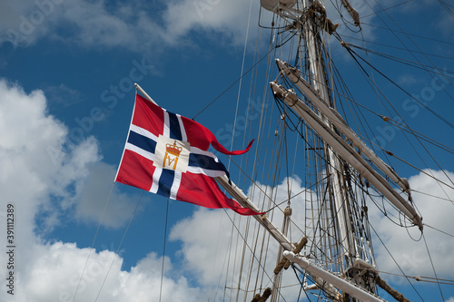 Canvas Print Halmstad, Sweden - July 18 2010: Norwegian flag with royal monogram on a sail ship