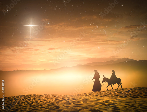 Fotografia Nativity Christmas concept: Silhouette pregnant Mary and Joseph with a donkey on