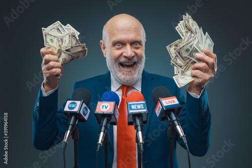 Obraz na plátne Greedy politician holding cash money