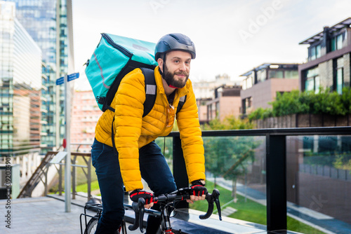 Food delivery, rider with bicycle delivering food Fototapet