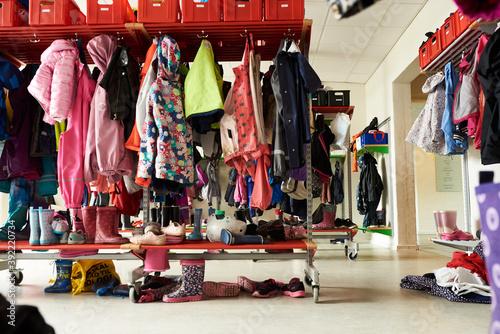Fotografia children coat rack with colorful clothes