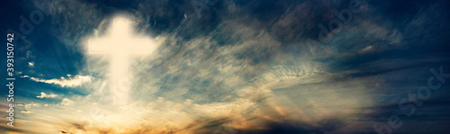 Fotografie, Obraz Silhouette of shining cross on sunset, sunrise background