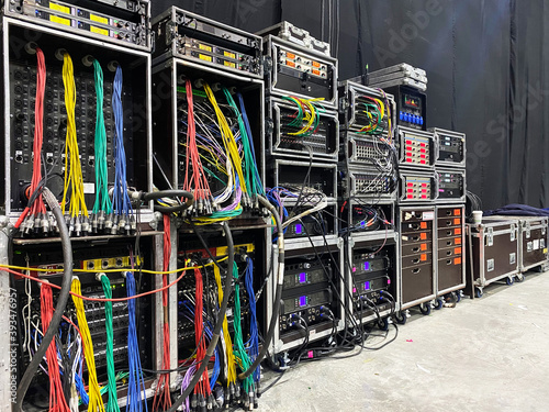 Fotografering Backstage area and tech zone with rack amplifiers, signal splitters, flight cases and radio microphone systems