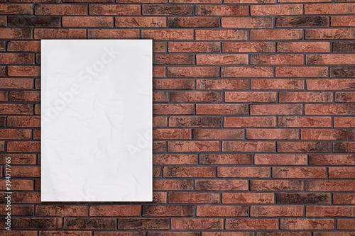 Canvas Print Blank creased poster on brick wall. Mockup for design
