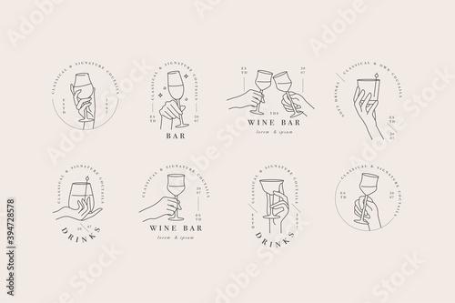 Obraz na plátně Vector design linear template logos or emblems - hands in in different gestures glass of drink