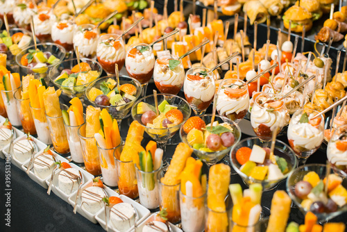 Fototapeta Photo of a lot of delicious fruit desserts and aperitives for a party