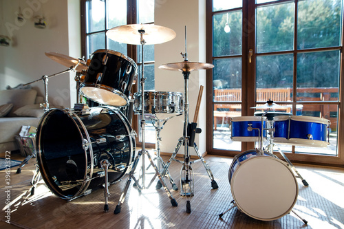 Stampa su Tela Set of drums indoors in living room in house, playing musical instrument concept