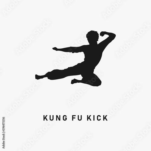 Kung Fu flying kick black silhouette Fototapeta