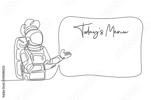 Fototapeta One single line drawing of young astronaut chef showing today's menu list on sign board vector illustration