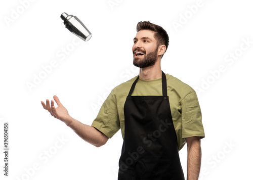Fotografie, Obraz alcohol drinks, people and job concept - happy smiling barman with shaker prepar