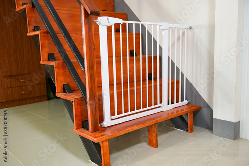 Leinwand Poster Baby gate safety door, white fence for safety children on stairs or dog gate