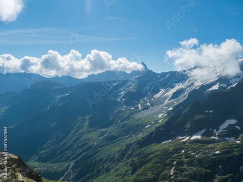 view on snow-capped moutains at Stubai hiking trail, Stubai Hohenweg, Alpine landscape of Tyrol, Stubai Alps, Austria. Summer blue sky