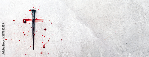 Billede på lærred Christian cross made with rusty nails, drops of blood on grey background