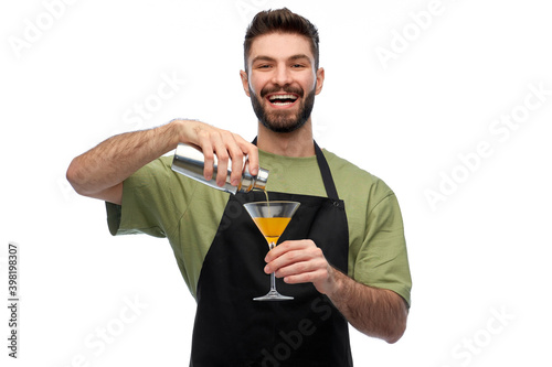 Fototapeta alcohol drinks, people and job concept - happy smiling barman in black apron wit