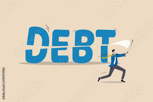Fotografía Cut debt, negotiate with bank or debtor to reduce amount of loan and mortgage payment, solution for money management concept, smart confidence businessman cutting or slice the word DEBT in half