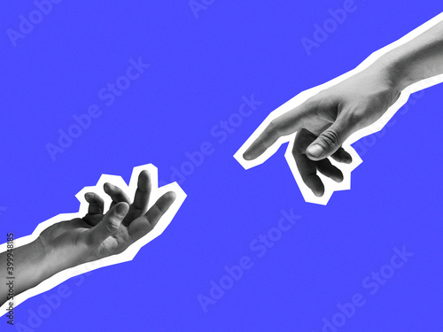 Fototapeta Two hands reaching out towards each other isolated on purple background