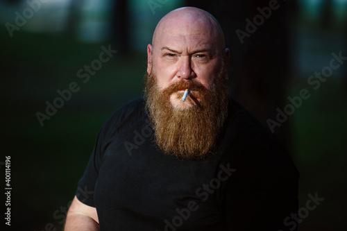 Fototapeta Portrait of a biker man with a big beard