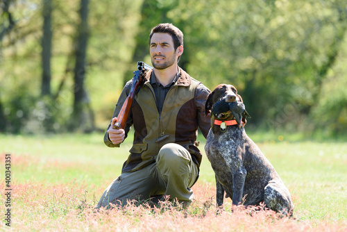 Obraz na plátne hunter and dog in field